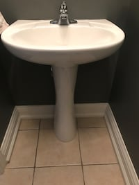 white ceramic pedestal sink with stainless steel faucet Vaughan, L6A