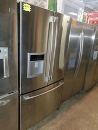 LG French Door Refrigerator stainless Steel working perfectly  Baltimore, 21223