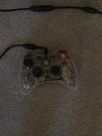 brown and black Xbox 360 controller