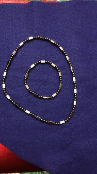 Black and silver -colored necklace &bracelets Revere, 02151