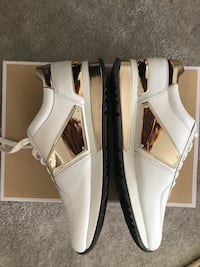 Pair of women's  white-and-gold leather shoes Michael Kors brand new.  Retail is $150+ Rockville, 20852