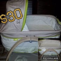 baby's white and green bassinet Hialeah, 33015