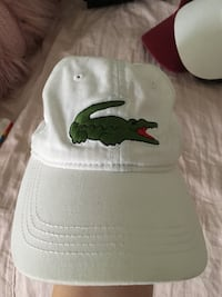 white and green Lacoste baseball cap