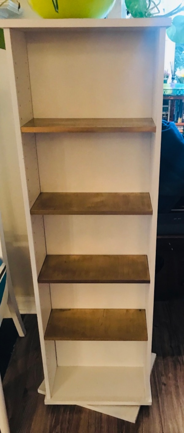 "Swiveled 2 sided book / entertainment shelves 48.5"" tall and 14"" wide"