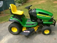 green and yellow John Deere ride on lawn mower Jefferson, 30549