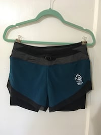 Size Small. Running Shorts with built in pockets for Water Bottles