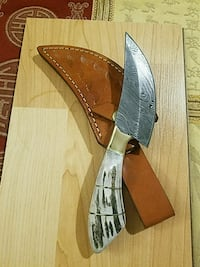 white handled knife with brown leather sheath Richardson, 75081