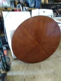 round table and two leafs plus 4 padded chairs