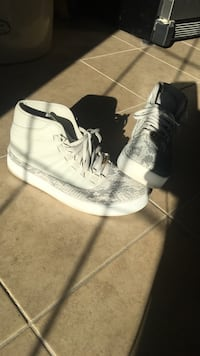 pair of beige-and-gray Snakeskin high-top sneakers