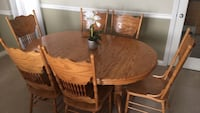 Round brown wooden table with six chairs dining set Surrey, V3T 5N3