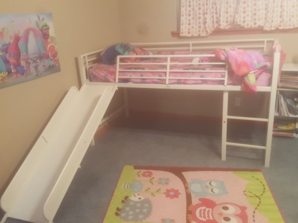 Twin bed with slide  daughter shown for height