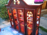 brown wooden framed glass display cabinet Fort Worth