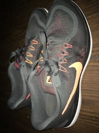 Pair of grey nike athletic shoes Mississauga