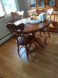 oval brown wooden table with four chairs dining set Halifax