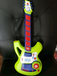 green and blue guitar toy
