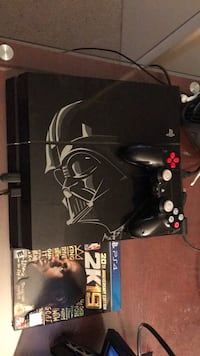 black Sony PS4 console with controller and game cases Woodbridge, 22193