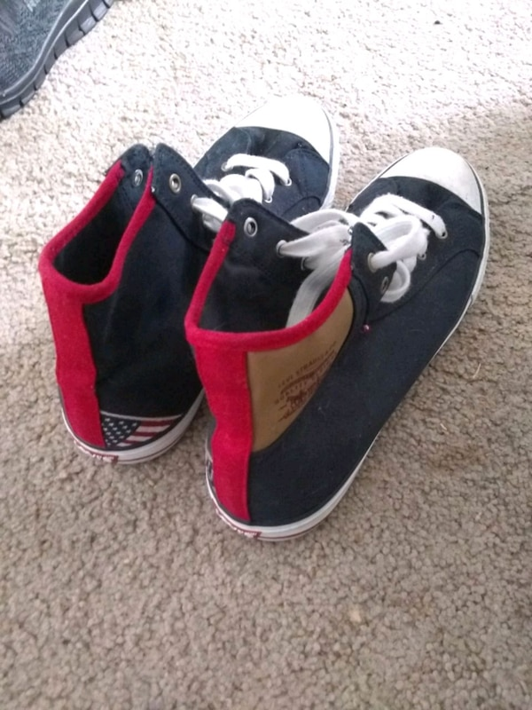 pair of black-and-red low top sneakers
