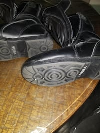 pair of black Vega leather racing boots