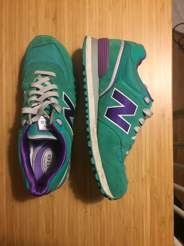 pair of green-and-purple New Balance sneakers