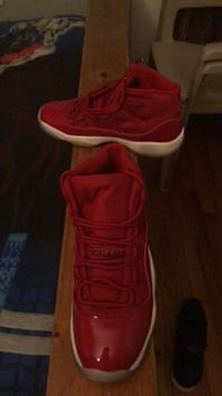 pair of red Nike basketball shoes New York, 10473