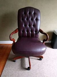 Brown leather padded rolling office chair