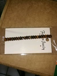 brown and white beaded necklace 996 mi