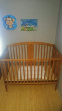 baby's brown wooden crib London, N5V 2C3