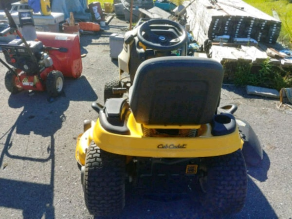 yellow and black ride-on mower