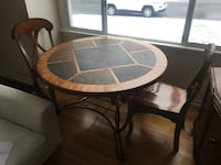 Round stone inlay table with four chairs Colwood, V9C 1C8