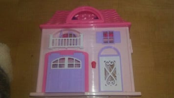 "doll house.  12"" by 6""-closed. .plastic"