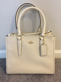 Coach. purse. New   Never been used. Has a crossover strap   White