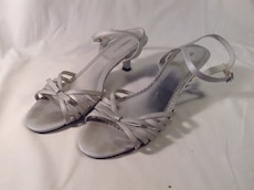 pair of silver-colored strappy heeled ankle strap sandals