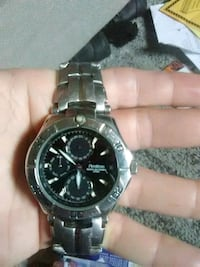 round silver chronograph watch with silver link br