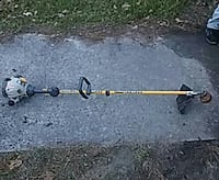 gray and yellow gas string trimmer