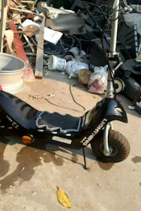 black and gray motor scooter 2402 mi
