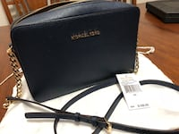 Authentic MK large saffiano travel crossbody bag, navy blue. In very good condition. No stain, clean inside. Dustbag included New Westminster, V3M