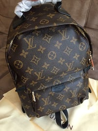 brown Louis Vuitton leather backpack Montreal