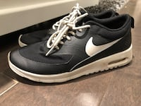 Pair of black nike running shoes ~ kids size 4Y Surrey, V3S 0X9