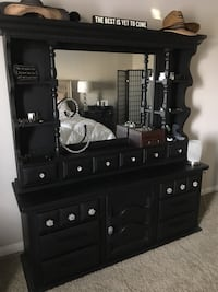 Black wooden dresser with mirror has legs that go with it. Very heavy and beautiful  Bakersfield, 93312