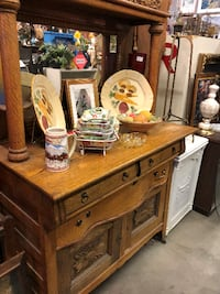 OAK SIDEBOARD/BUFFET, BEVELED MIRROR, SERPENTINE CARVED FRONT, 3 DRAWERS, 2 DOORS, ROUND CARVED PILLARS, WITH CARVED TOP AND SHELF. cc:1910-30's, great condition, to see call  [TL_HIDDEN] , $795.00 purchased 1995 for $1,500.00 null