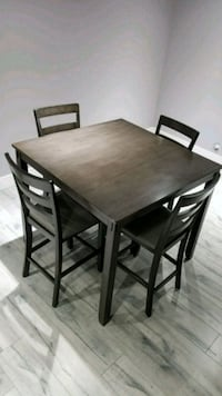 rectangular brown wooden table with four chairs dining set Surrey, V3V 3M5