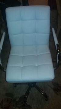White leather office chair,adjustable, swivel seat with wheels. New.