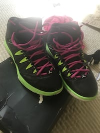 Pair of black-and-green nike basketball shoes 444 mi