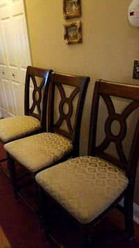 "Three 24"" brown wooden-framed beige-padded chairs Amityville, 11701"