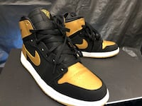 pair of black-and-yellow Nike Air Force Compton, 90221