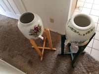 White and green floral ceramic vase each one 30 broken knob still works other 40.00 Palmdale, 93552