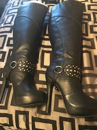 Pair of black leather ankle-buckle stiletto-heeled knee-high boots Florence, 39073