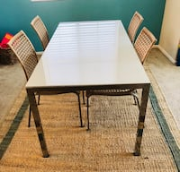 rectangular brown wooden table with four chairs dining set Los Angeles, 91367
