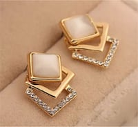 Fashion Women Gold Plated Jewelry Hollow Rhinestone Cat Eye Opal Stud Earrings London