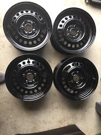 5 lugs wholes 14 inch rim good condition  newly painted steel rim good for Toyota carol-a looking for best offer Thanks Brampton, L6V 0W2